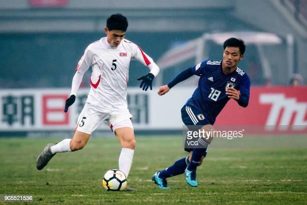 Ri Un-Chol of North Korea controls the ball during the AFC U-23 Championship Group B match between Japan and North Korea at Jiangyin Stadium on...