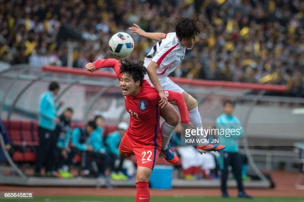 Ri UnYong of North Korea jumps for the ball against Lee Geummin of South Korea during their AFC Women's 2018 Asian Cup Group B qualifying football...
