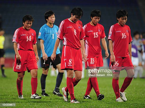 Ri Yong Mi, Kim Yun Mi, Kim Un Ha and Kang Ok Gum of North Korea are dejected at the end of the FIFA U17 Women's World Cup Semi Final match between...