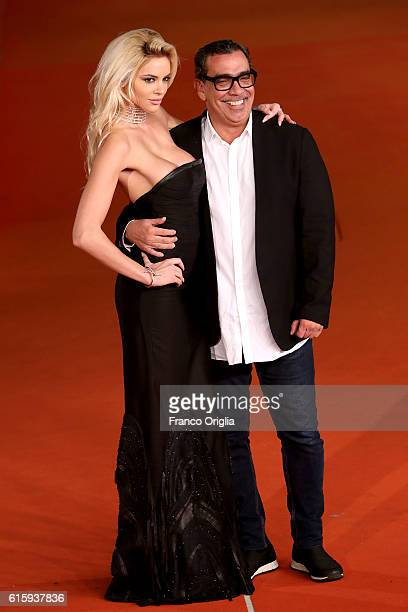 Ria Antoniou and Guillermo Mariotto walk a red carpet for 'Florence Foster Jenkins' during the 11th Rome Film Festival at Auditorium Parco Della...