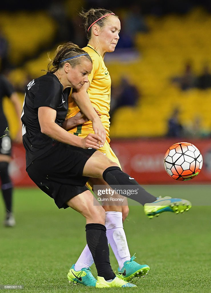 Ria Percival of New Zealand and Caitlin Foord of Australia compete for the ball during the Women's International Friendly match between the Australia Matildas and the New Zealand Football Ferns at Etihad Stadium on June 7, 2016 in Melbourne, Australia.
