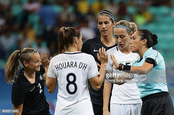 Ria Percival of New Zealand and Jessica Houara of France talk with referee Lucila Venegas during the Women's Football match between New Zealand and...