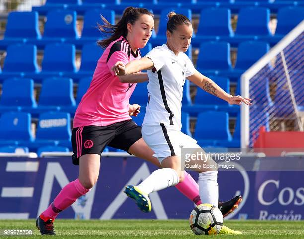 Ria Percival of New Zealand competes for the ball with Jennifer Beattie of Scotland during the international friendly match between New Zealand Women...