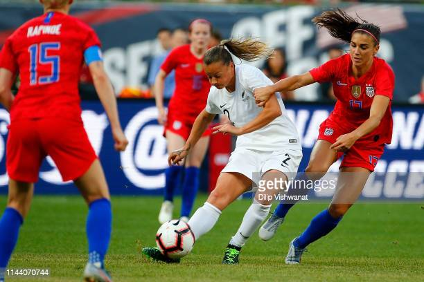 Ria Percival of New Zealand gains possession of the ball from Alex Morgan of the United States at Busch Stadium on May 16 2019 in St Louis Missouri