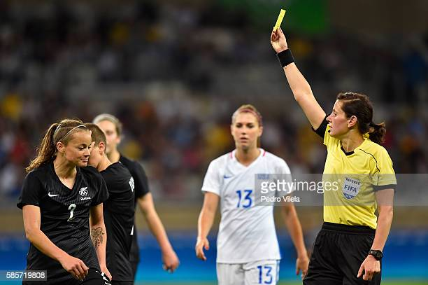 Ria Percival of New Zealand receives a yellow card in the Women's Group G first round match between the United States and New Zealand during the Rio...