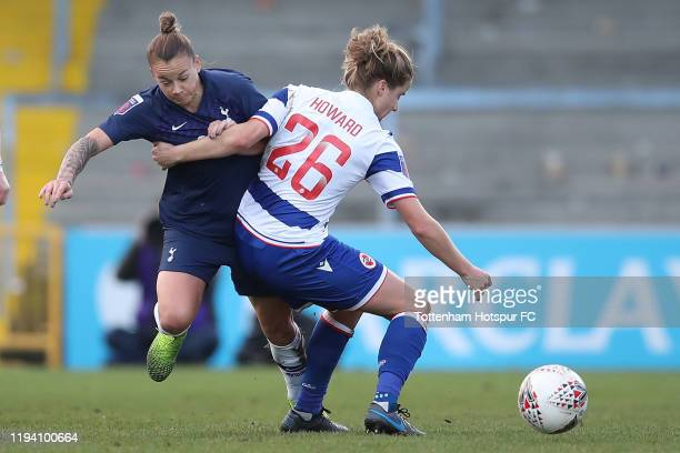 Ria Percival of Spurs battles with Sophie Howard of Reading during the Barclays FA Women's Super League match between Reading and Tottenham Hotspur...