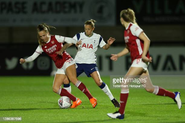 Ria Percival of Tottenham Hotspur and Katie McCabe of Arsenal battle for the ball during the FA Women's Continental League Cup match between Arsenal...