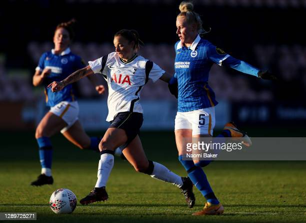 Ria Percival of Tottenham Hotspur is challenged by Danique Kerkdijk of Brighton & Hove Albion during the Barclays FA Women's Super League match...