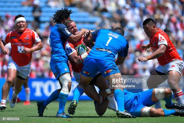 Riaan Viljoen of Sunwolves is tackled during the Super Rugby match between the Sunwolves and the Blues at Prince Chichibu Stadium on July 15 2017 in...