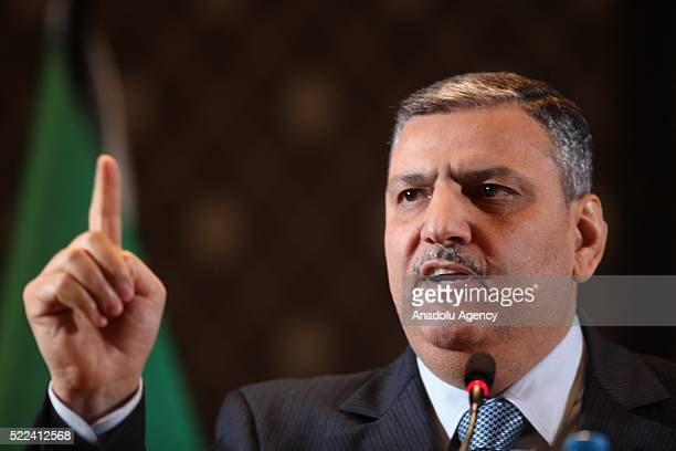 Riad Hijab chief coordinator of the Syrian opposition High Negotiations Committee gestures as he speaks during his press conference in...