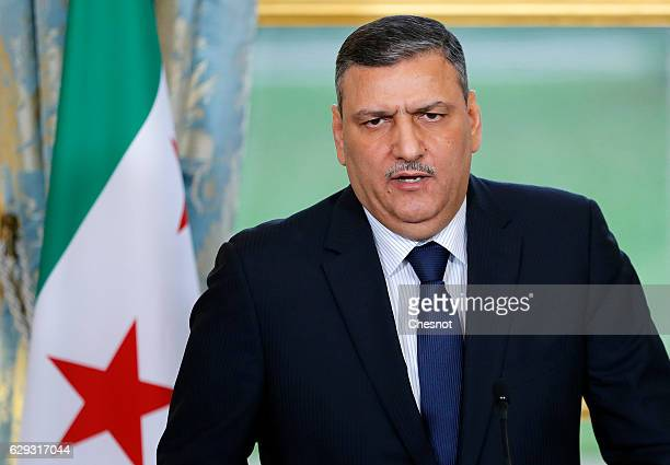 Riad Hijab chief coordinator of the Syrian opposition's High Negotiations Committee delivers a speech during a press conference with French President...