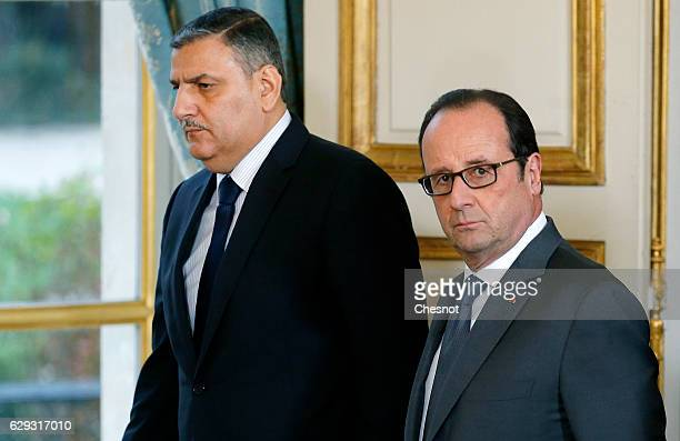 Riad Hijab chief coordinator of the Syrian opposition's High Negotiations Committee and French President Francois Hollande arrive to attend a press...