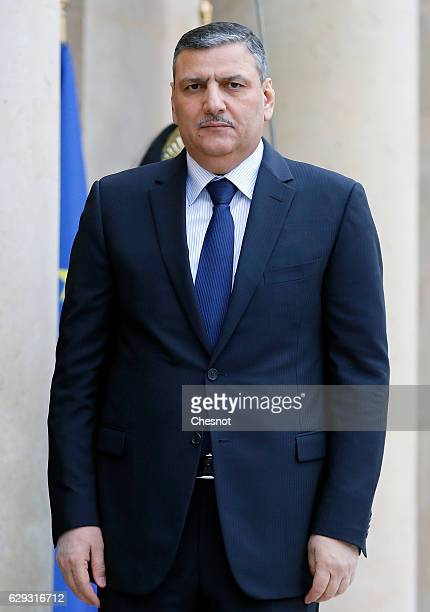 Riad Hijab chief coordinator of the Syrian opposition's High Negotiations Committee poses as he arrives prior to a meeting with French President...