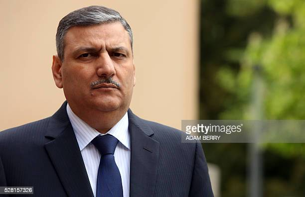 Riad Hijab head of the Syrian High Negotiation Committee gives a statement to the press at the foreign ministry's guest house Villa Borsig in the...