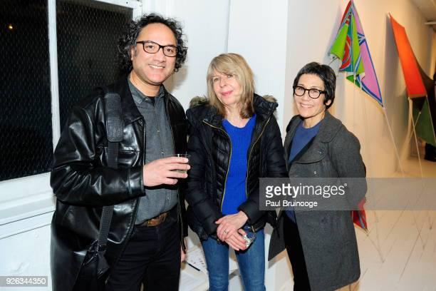 Riad Miah Amanda Church and Kim Uchiyama attend Joe Overstreet Innovation of Flight Paintings 19671972 at Eric Firestone Gallery on March 1 2018 in...