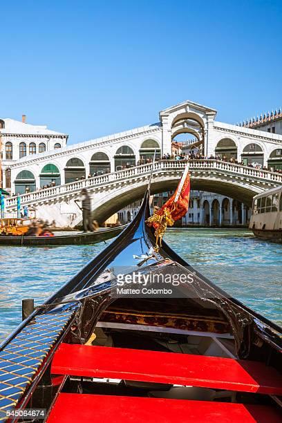 RIalto bridge and gondola prow, Venice, Italy