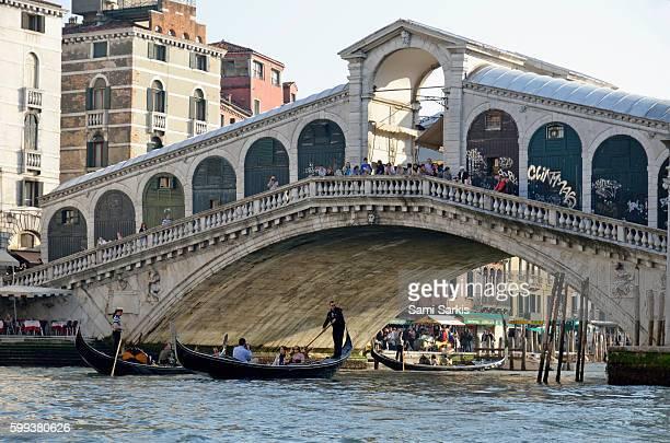 Rialto Bridge on the Grand Canal, Venice, Italy, Europe with gondolas beneath