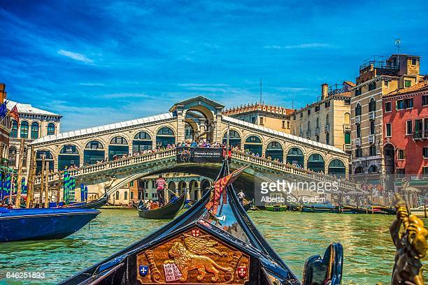 Rialto Bridge Over Grand Canal Against Sky In City