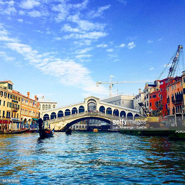 Rialto Bridge Over Grand Canal Against Sky
