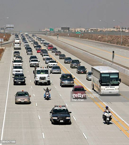 Rialto, July 24, 2007 – – – CHP leads the first traffic onto East bound of the long–awaited freeway extension that links the 210 Freeway to Highway...