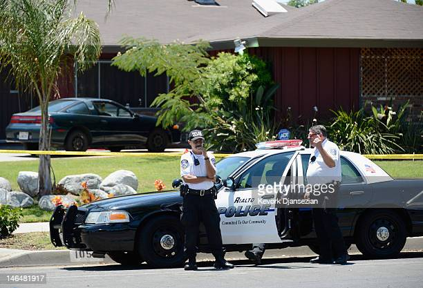 Rialto police officers and volunteers keep watch in front of Rodney King's home after he was found dead on June 17, 2012 in Rialto, California. King,...