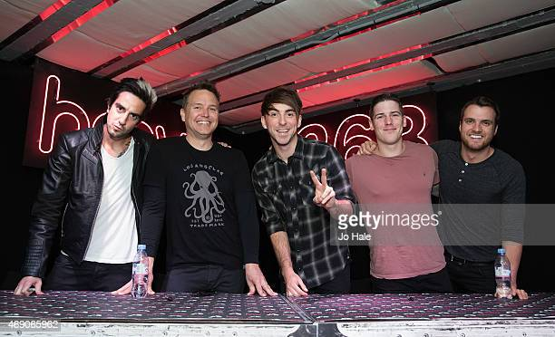 Rian Dawson Jack Barakat Alex Gaskarth and Zack Merrick of All Time Low with their guest Mark Hoppas of Blink 182 sign copies of their New Album...