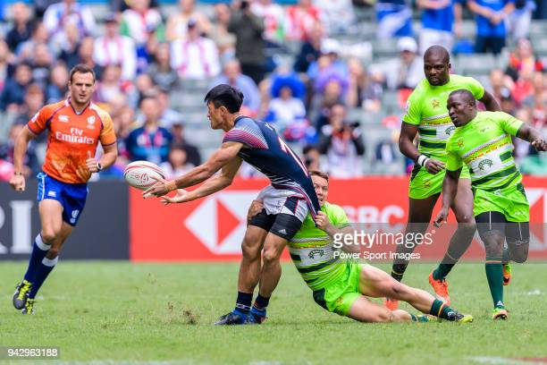 Rian O'Neil of Zimbabwe puts a tackle on Yiu Kam Shing of Hong Kong during the match between Hong Kong and Zimbabwe on April 7 2018 in Hong Kong Hong...