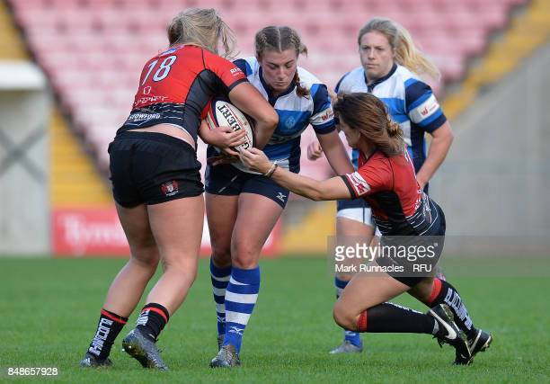 Rianna Manson of Darlington Mowden Park Sharks is tackled by Molly Morrissey and Gemma Sharples of GloucesterHartpury Women's RFC during the Womens...