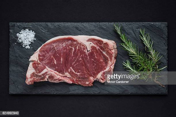 rib eye steak - metal grate stock photos and pictures