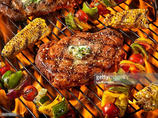 BBQ Rib Eye Steaks with Herb Butter,corn and Kabobs