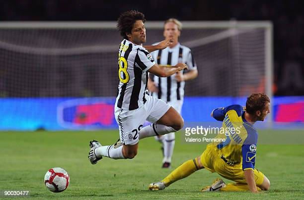Ribas Da Cunha Diego of Juventus battles for the ball with Michele Marcolini of Chievo during the Serie A match between Juventus FC vs AC Chievo...