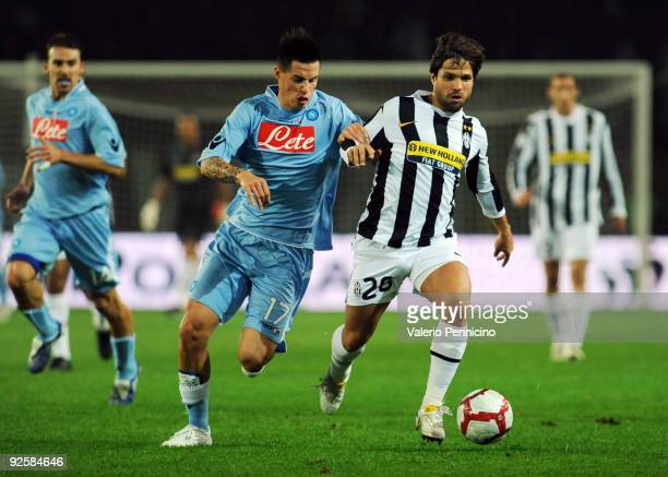 Ribas Da Cunha Diego of Juventus FC battles for the ball with Marek Hamsik of SSC Napoli during the Serie A match between Juventus FC and SSC Napoli...