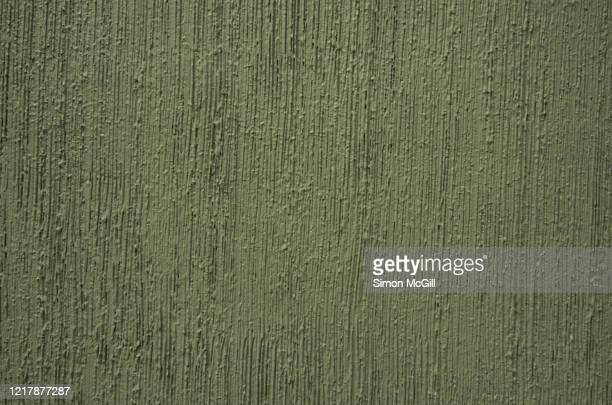 ribbed concrete stucco building exterior wall painted khaki/olive green - khaki green ストックフォトと画像