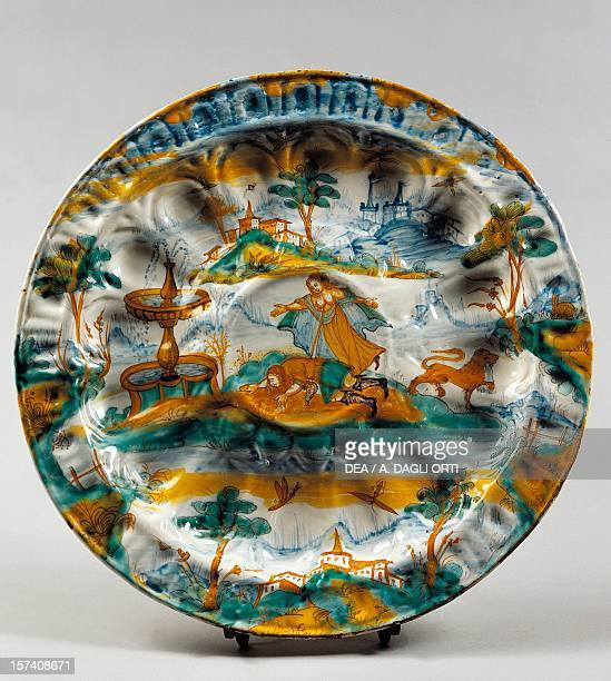 Ribbed plate with the image of the fountain of love and myth of Pyramus and Thisbe, ceramic, Albisola manufacture, Liguria. Italy, 17th century....