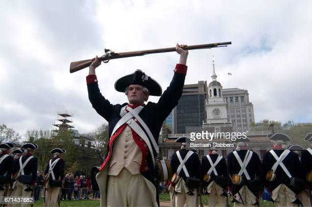 ribben cutting of museum of the american revolution - revolutionary war soldier stock photos and pictures