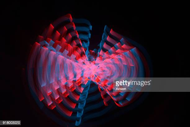 led ribbon light painting in space - blur background stock-fotos und bilder