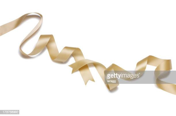 ribbon of gold - ribbon stock pictures, royalty-free photos & images