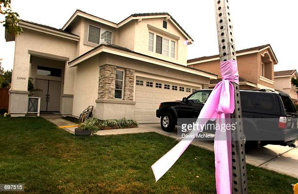 A ribbon of hope is tied to a stop sign outside the house of David Westerfield the only suspect in the case of missing sevenyearold Danielle van Dam...