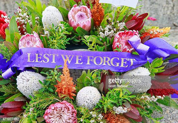 A ribbon with 'Lest We Forget' written on it adorns a floral tribute at the base of the Shrine of Remembrance after the 2015 Dawn Service on ANZAC...