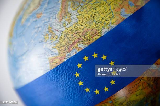 A ribbon with the logo of the European Union is bound around a globe on February 08 2018 in Berlin Germany