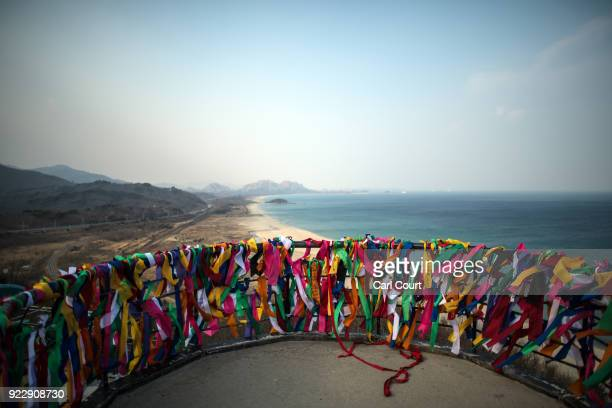 Ribbons bearing goodwill messages are tied to a viewing platform at Goseong Unification Observatory near the Korean Demilitarized Zone on February 22...