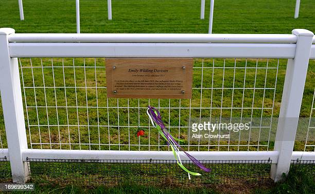 Ribbons catch the breeze beneath a plaque on Tattenham Corner commemorating suffragette Emily Wilding Davison who threw herself under the kings horse...
