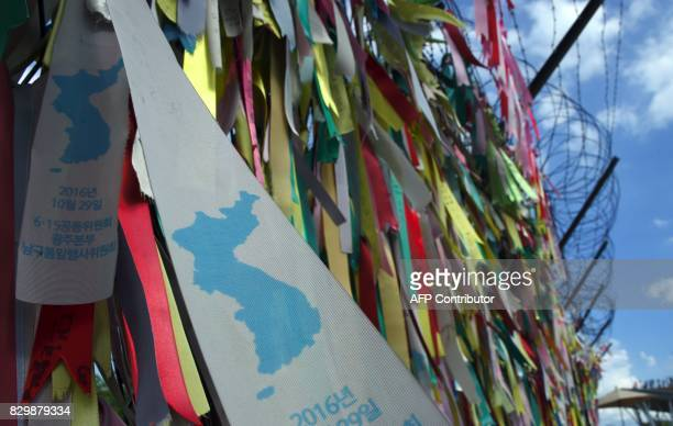 Ribbons with inscriptions calling for peace and reunification are displayed on a military fence at Imjingak peace park near the Demilitarized Zone...