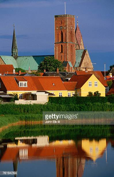 Ribe Domkirke and town buildings reflected in water, Ribe, Denmark, Europe