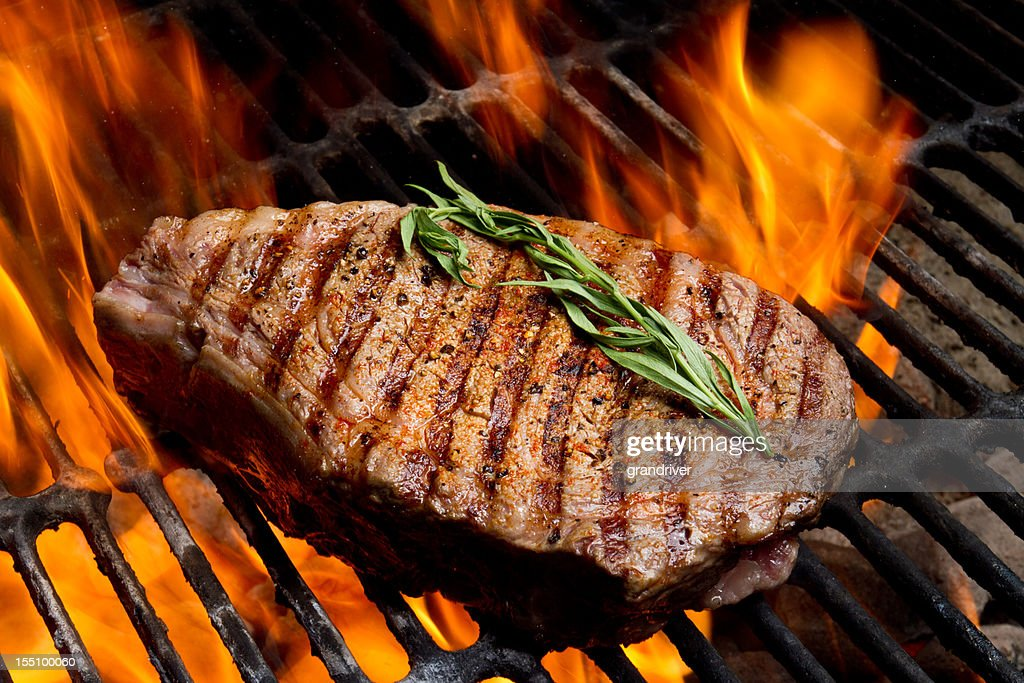 Ribeye Steak on Grill with Fire : Stock Photo