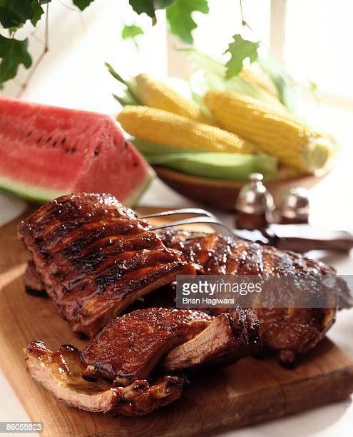 bbq ribs on cutting board - sparerib stock photos and pictures