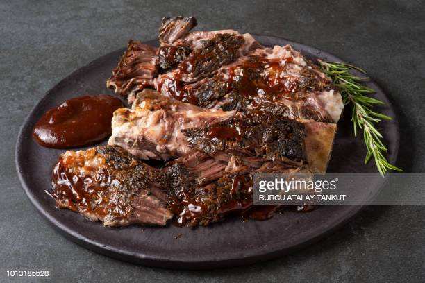 ribs with barbecue sauce - barbeque sauce stock photos and pictures