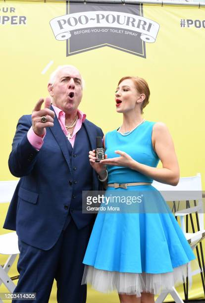Ric Flair and Poo-Pourri Spokeswoman Bethany let it go during Poo-Pourri's Giant Poo In Miami at The Wynwood Marketplace on February 01, 2020 in...