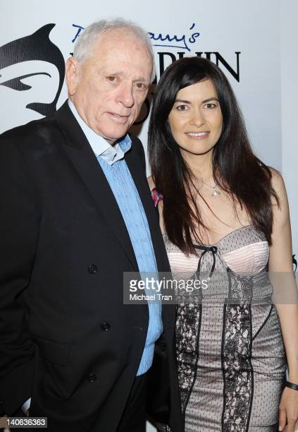 Ric O'Barry and Leilani Munter attend the cocktail reception honoring Richard O'Barry star of the OscarWinning Documentary The Cove held at a private...