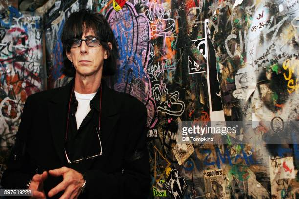 Ric Ocasek, lead singer of The Cars, posing in the Men's Room of club CBGB's on September 29, 2005 in New York City.